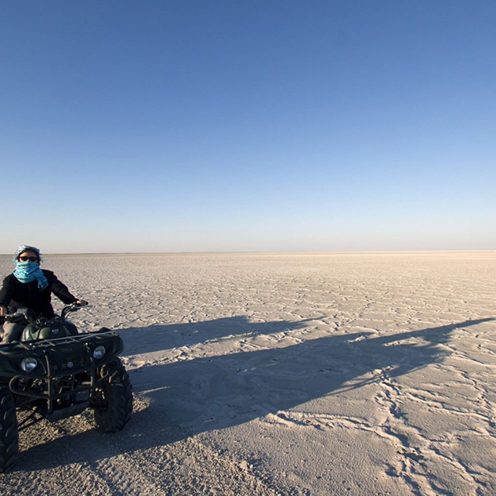 Africa Geographic client Rosa out for an afternoon quad bike drive on Makgadikgadi Pan. Christian Boix
