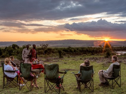Enjoying sundowners at Sentinel Mara Camp, Kenya