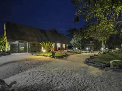 Outside view of Nkorho Bush Lodge at night in Sabi Sands, Greater Kruger
