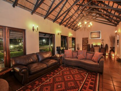 Relax in the lounge at Nkorho Bush Lodge in Sabi Sands, Greater Kruger